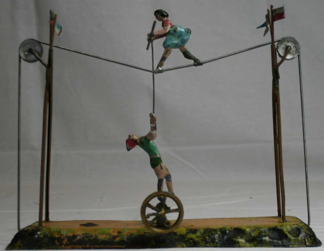 bing steam toy drive model woman with pole on tightrope including a man