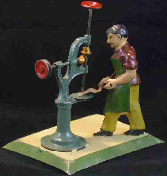 Carette Antriebsmodell Handwerker an Bohrmaschine