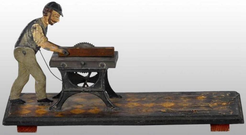 carette dampfspielzeug antriebsmodell mann sägt ein stück holz in zwei hälften