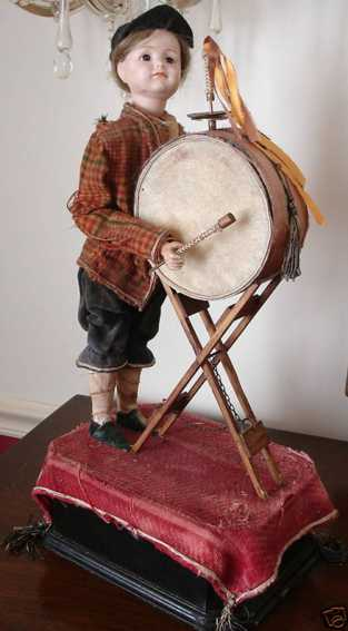 kammer & reinhardt 114 automaton drummer boy, the doll stands 40,6 cm on a 10,2 cm base. the