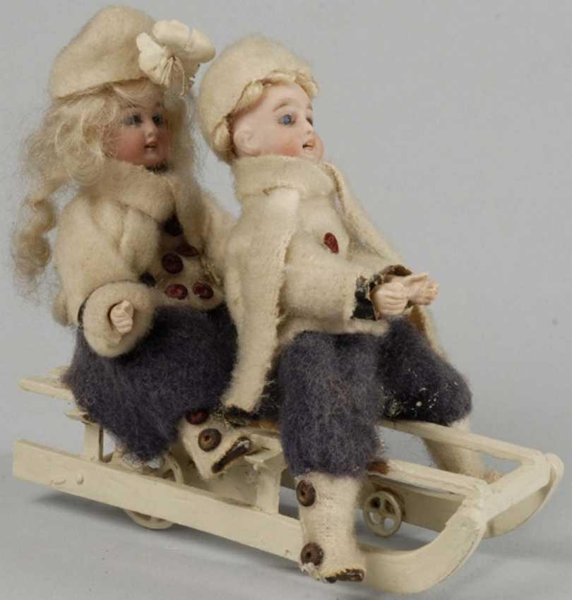 Kuehnlenz Gebrueder Kuhnlenz Gebruder Automaton Bisque head boy and girl on sled