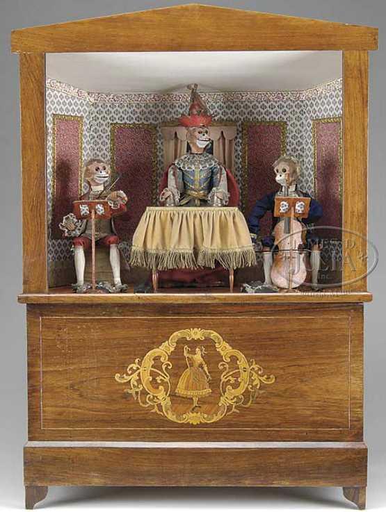 theroude alexandre automat handkurbeldrehorgel mit zauberer in der mitte flankiert von