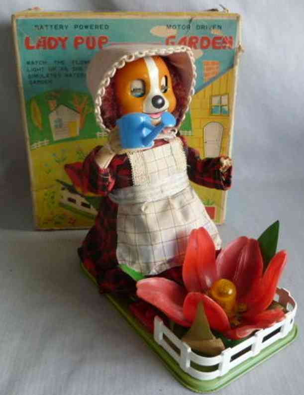 tomiyama trading co. ltd automaton lady pup tending her garden