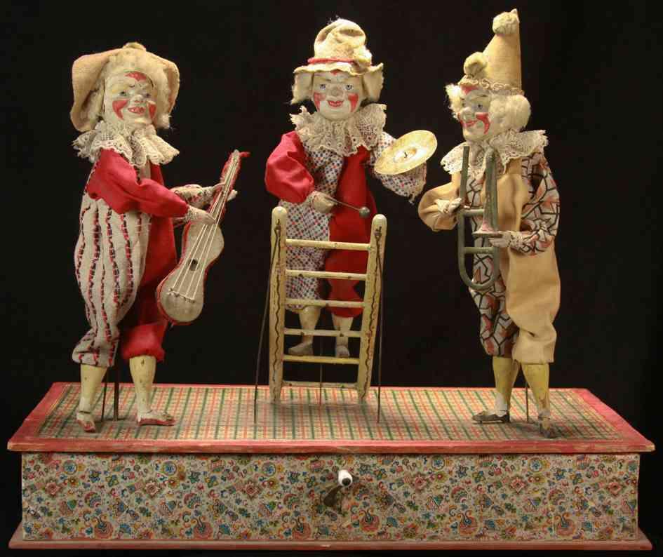 deutscher automat mit kuberbelspieldose mit drei clowns