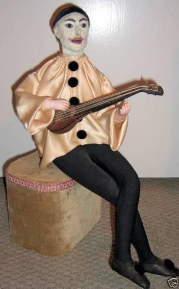 vichy automat jester spielt mandoline, aufgezogen bewegt er seine hand rau
