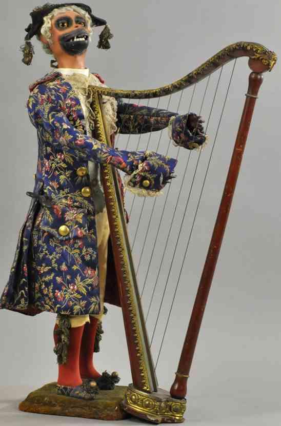 vichy automat affe als harfenspieler steht auf sockel