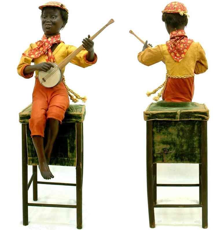 vichy schwarzer junge mit banjo als automat