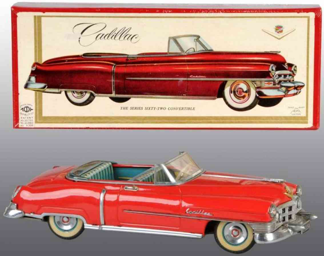 alps tin toy car cadillac with friction drive and hood ornament