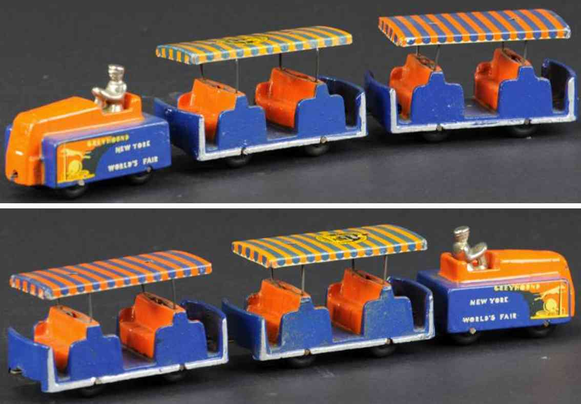 arcade 729 cast iron toy fair bus  train 2 supporters orange blue