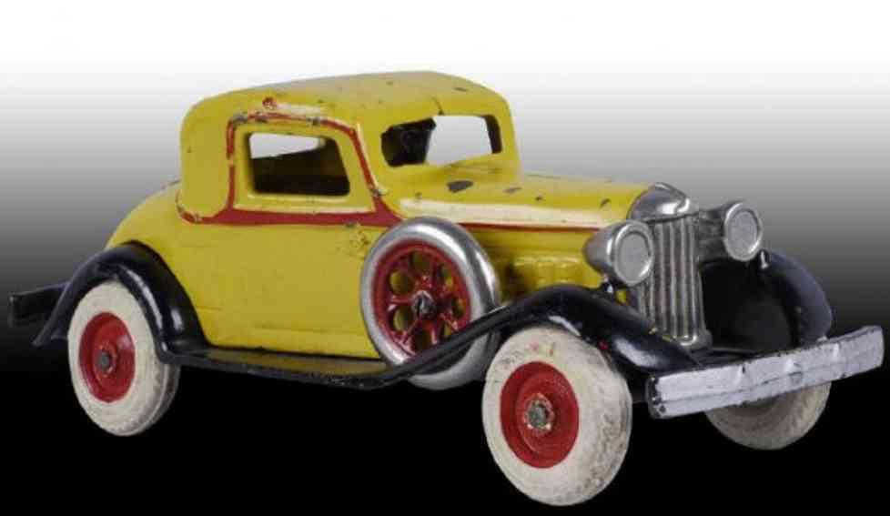 arcade 1247 spielzeug gusseisen auto coupe gelb fahrer