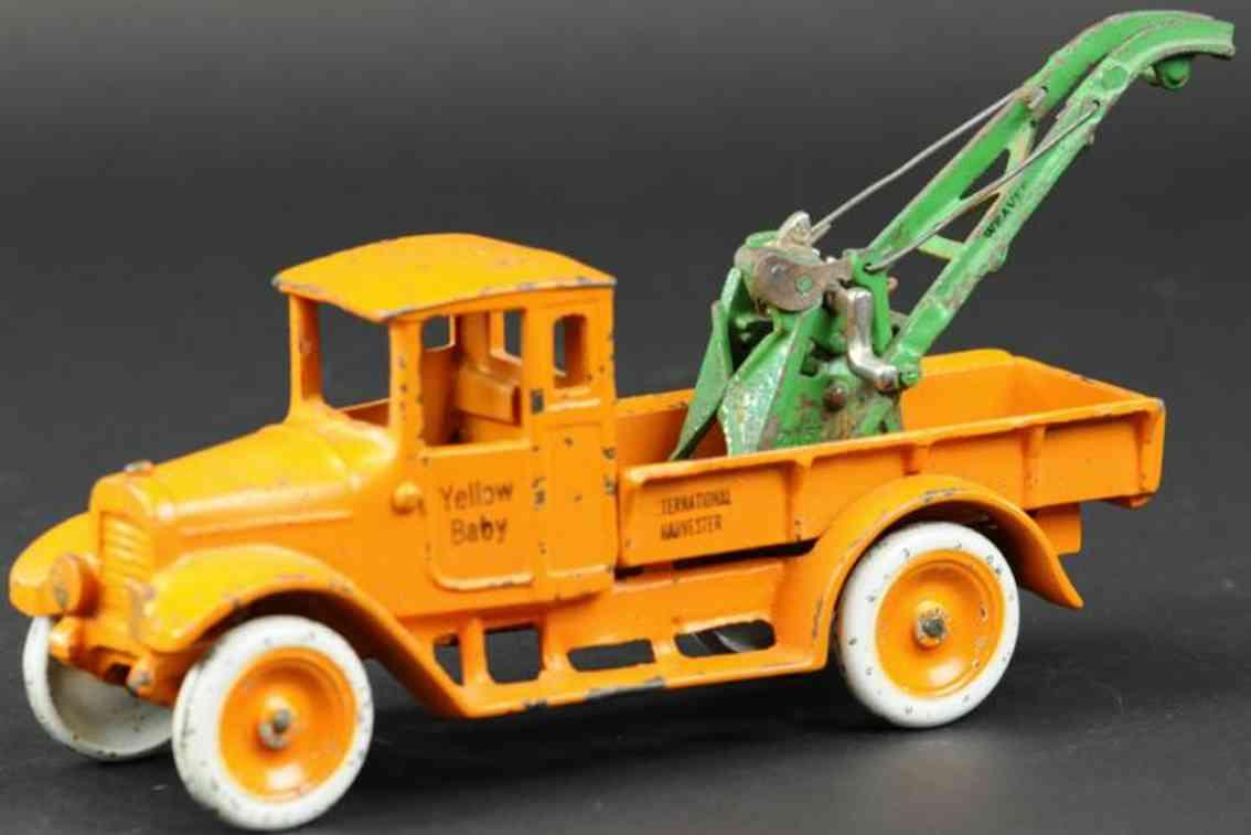 arcade cast iron toy yellow baby truck orange
