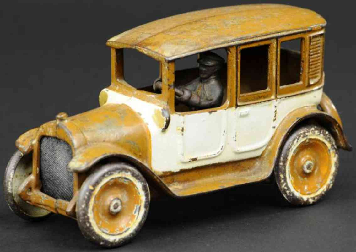 arcade cast iron toy car brown and white cab
