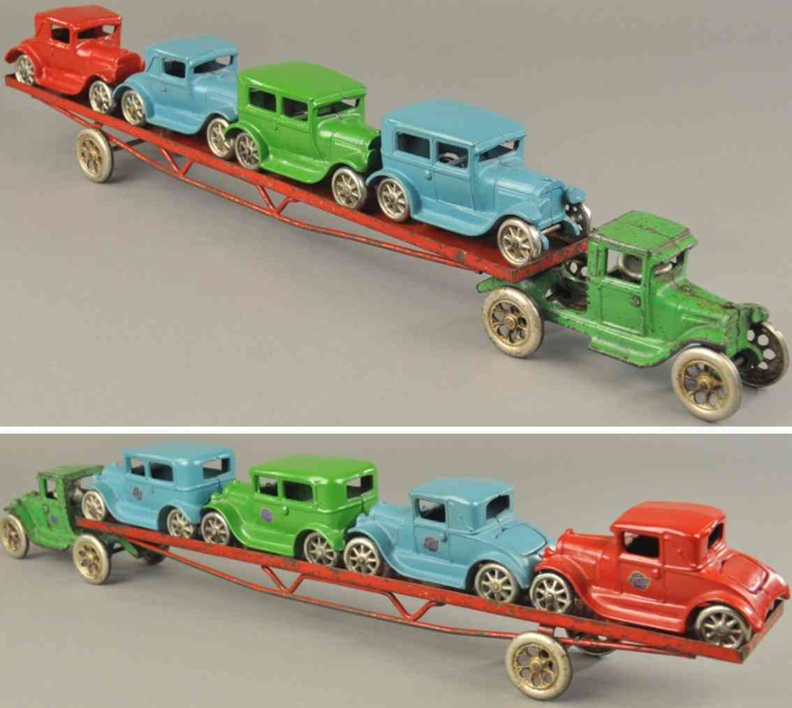 arcade cast iron toy cariier transport car four coupes sedan green red blue