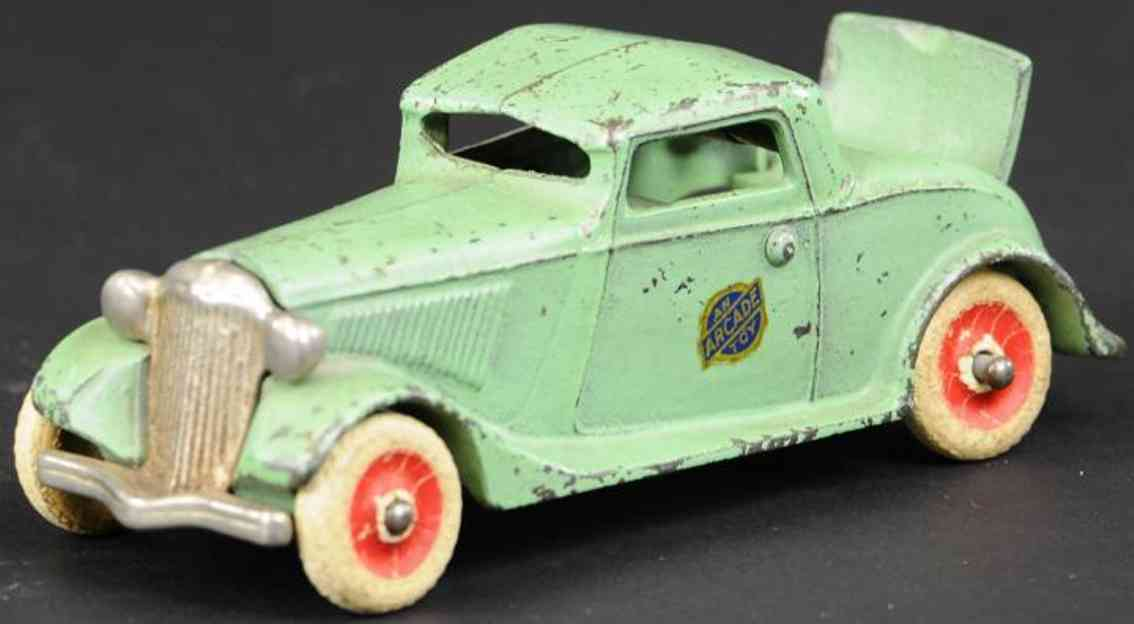 arcade cast iron toy car coupe rumble seat green