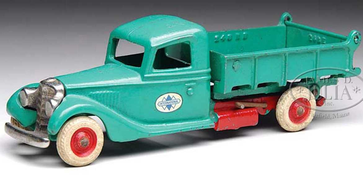 arcade cast iron toy international dump truck green