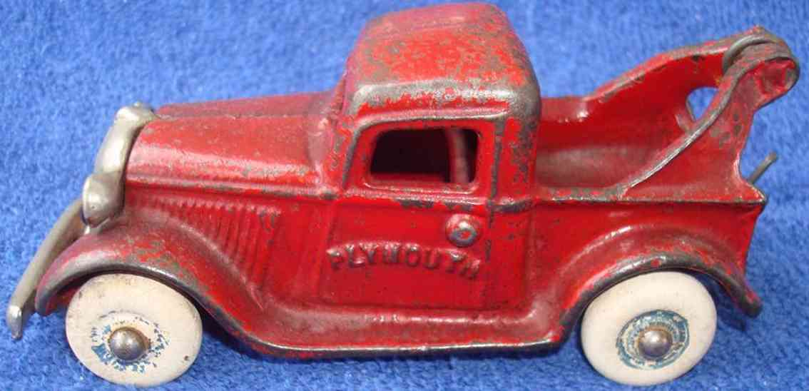 arcade cast iron toy truck plymouth wrecker red