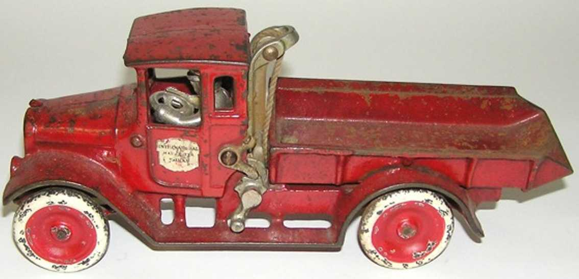 arcade cast iron toy red baby dump truck toy driver