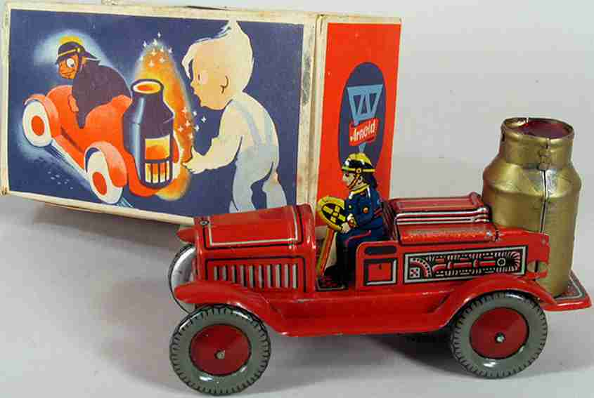 arnold 640 tin toy fire engine wind up steam boiler