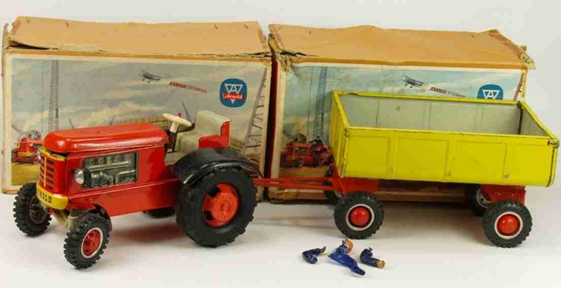 arnold 7350 und 6750 tin toy tractor and supporter