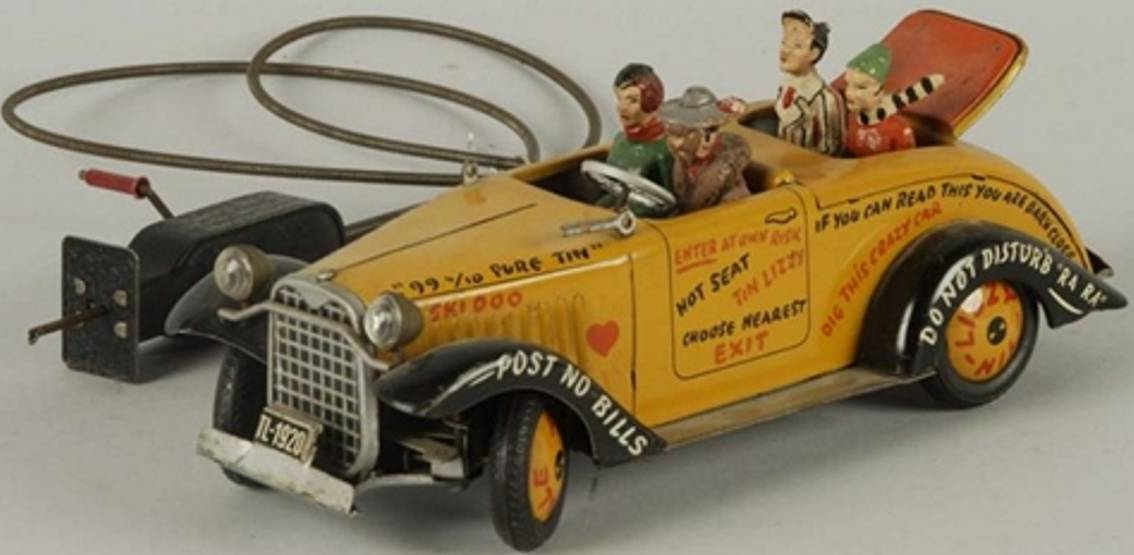 arnold tin toy car jalopy with cable four composition figures yellow