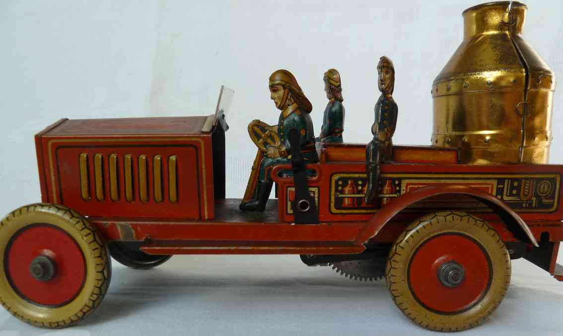 arnold tin toy fire engine pump car with 3 crew