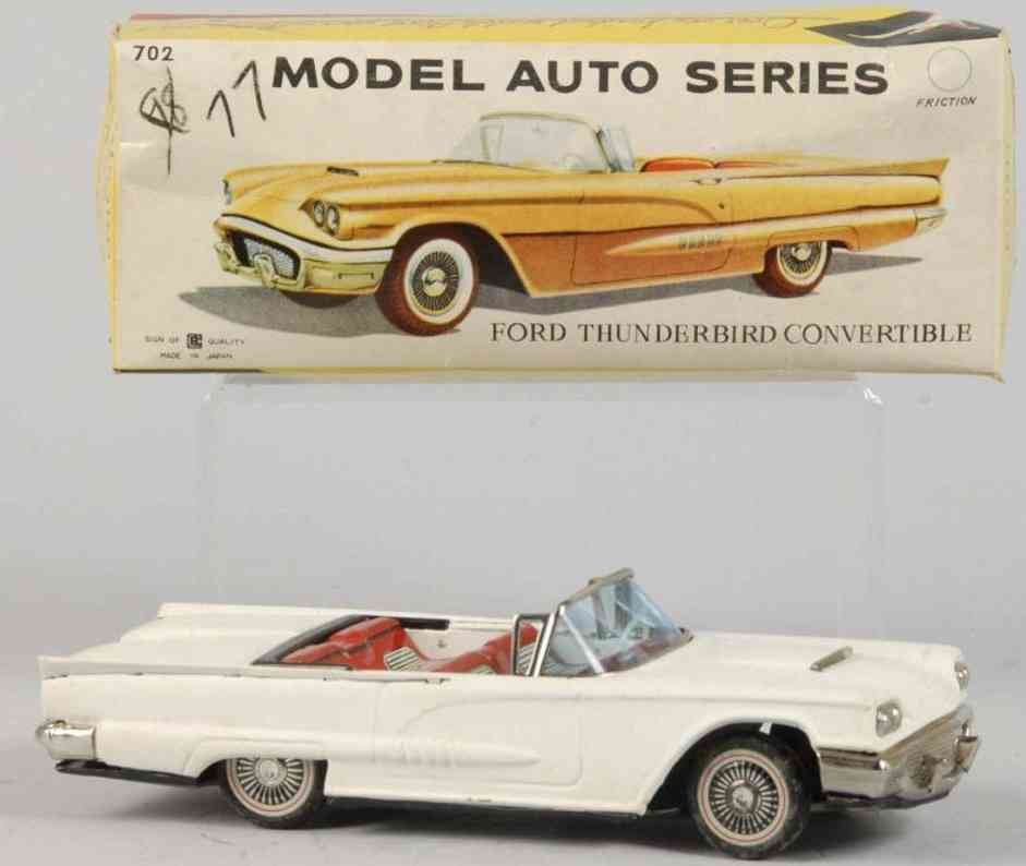 bandai 702 tin toy car ford thunderbird white friction drive