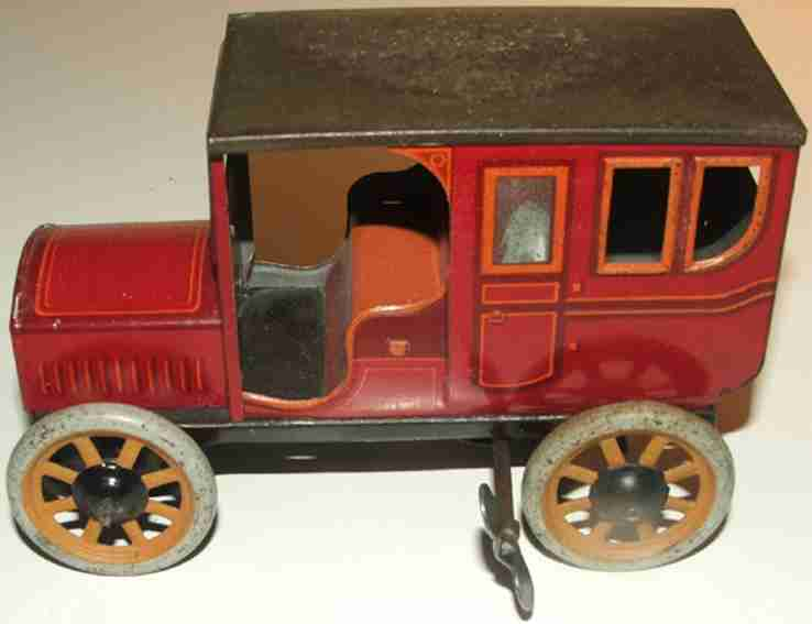 bing 10384/1 tin toy car coupe clockwork feather engine red orange
