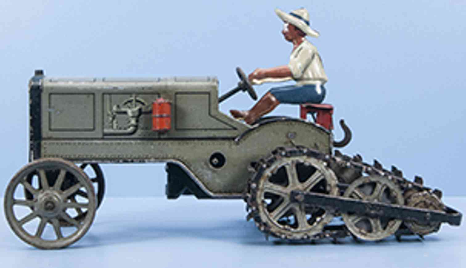 bing tin toy half-track tractor with driver figure gray