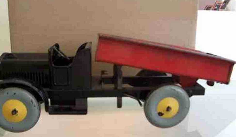 brown george tin toy truck tipping truck
