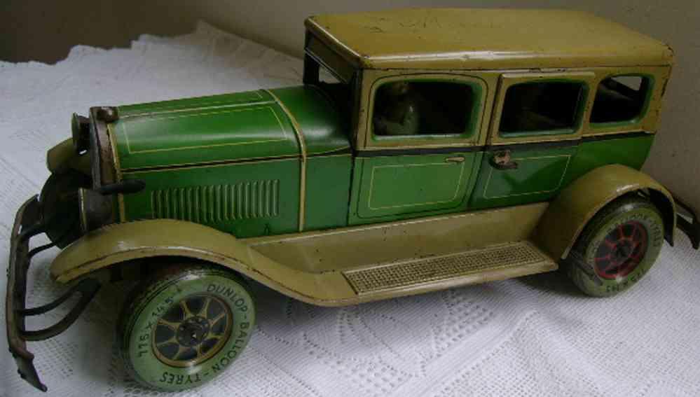 karl bub 788 tin toy car green beige clockwork driver