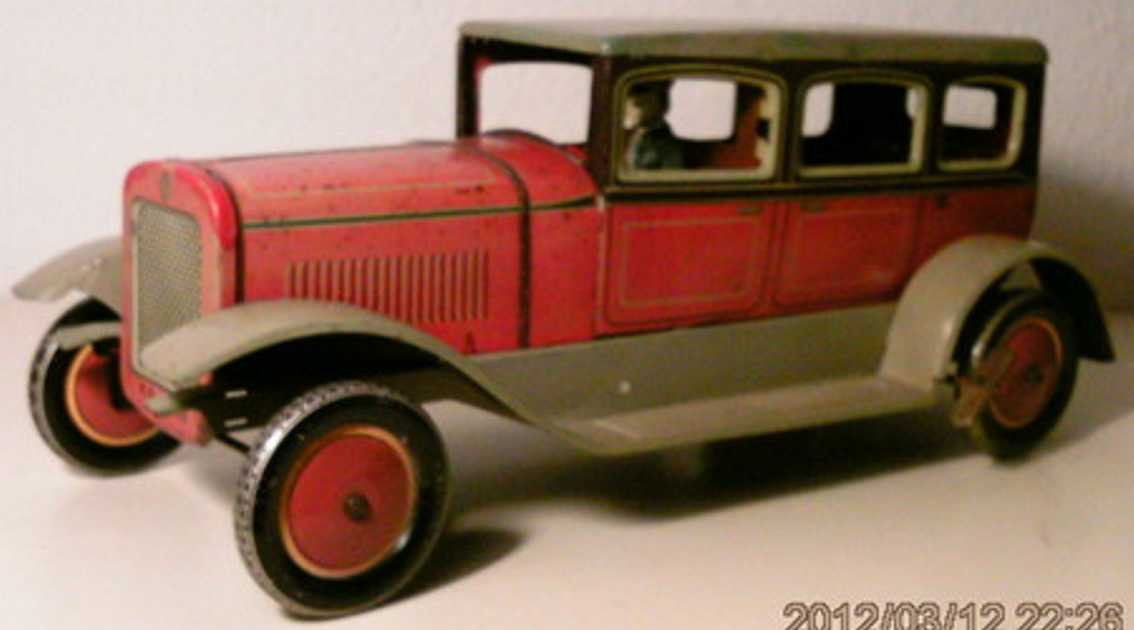 karl bub 788 tin toy car limousine red beige clockwork driver