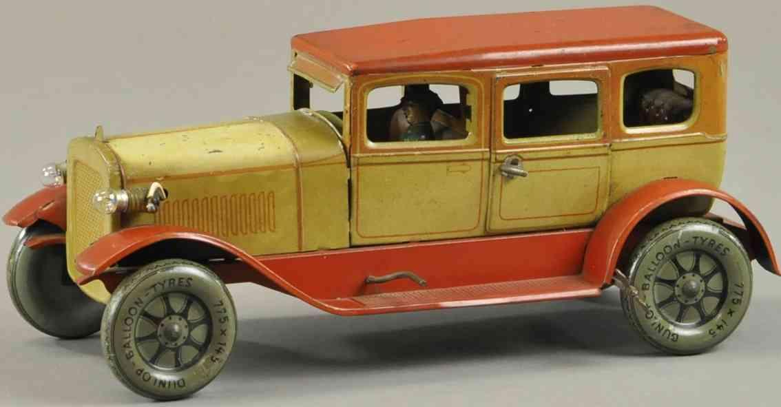 karl bub blech spielzeug auto luxus limousine gelb orange fahrer uhrwerk