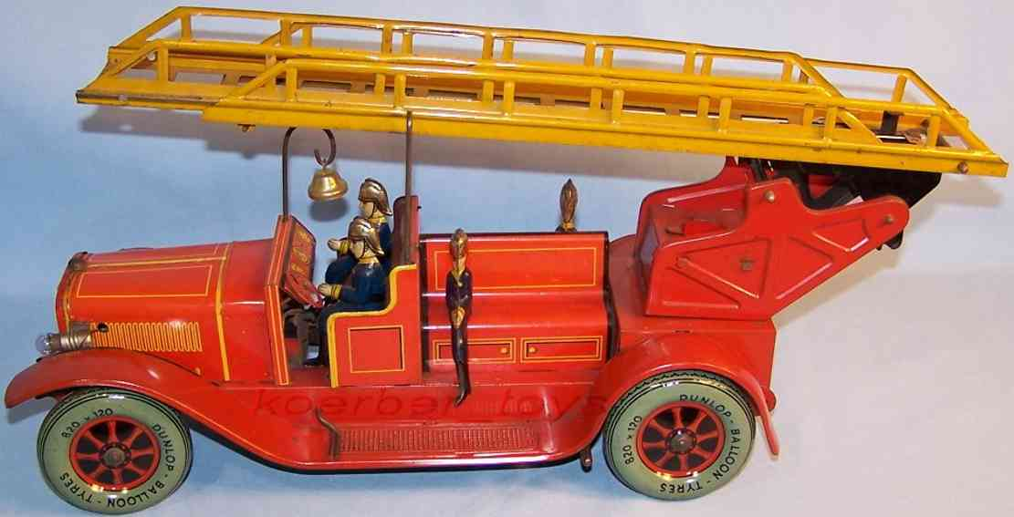 karl bub 788 tin toy fire engine fire ladder car with clockwork in red