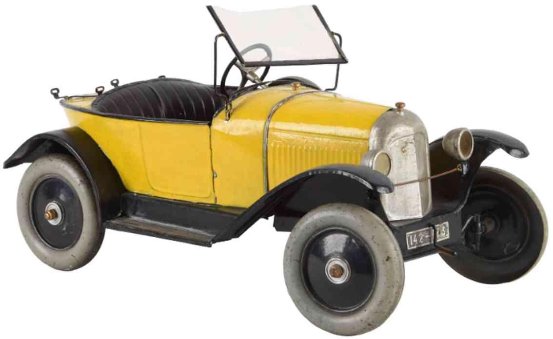 cij tin citroen boat tail race car wind-up toy yellow