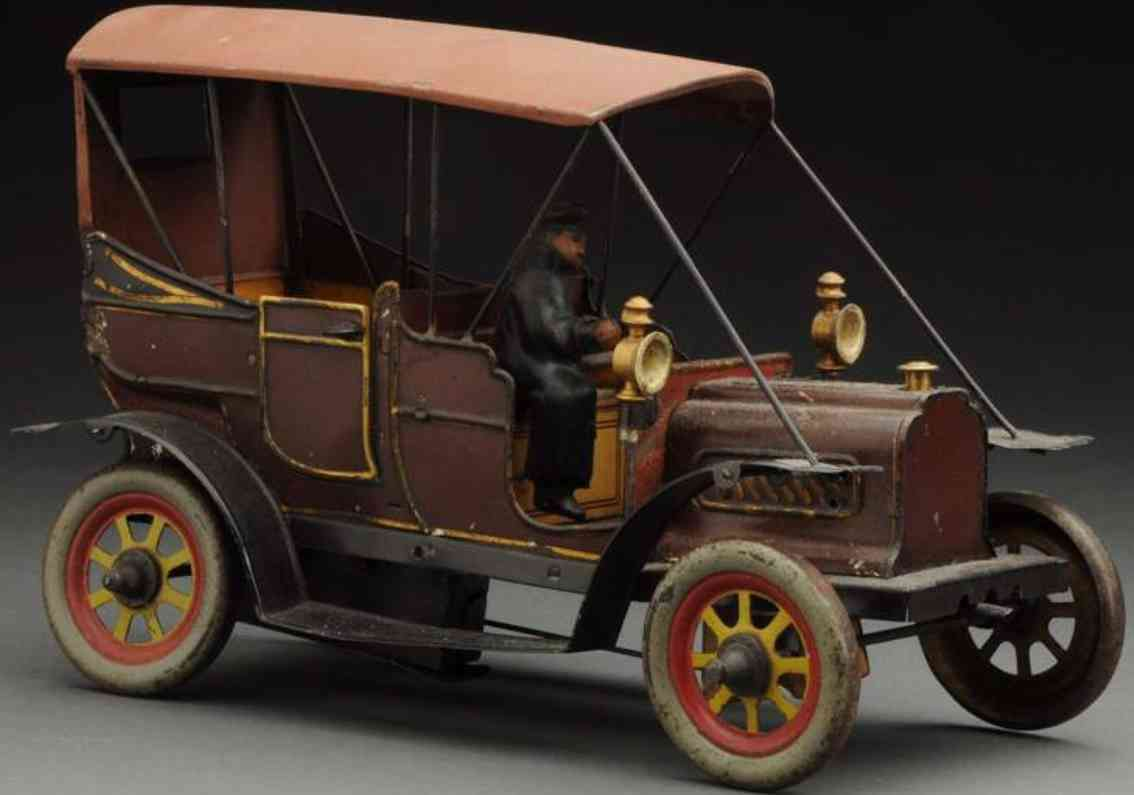 carette tin toy car early wind-up car brown