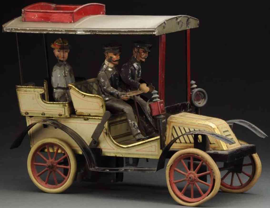 carette tin toy car phaeton auto with clockwork 3 figures