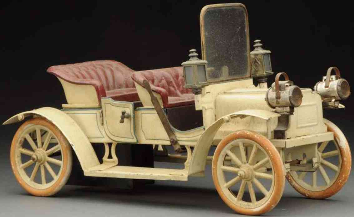 carette tin toy car early open touring car