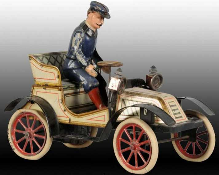 carette tin toy car touring automobile open clockwork driver
