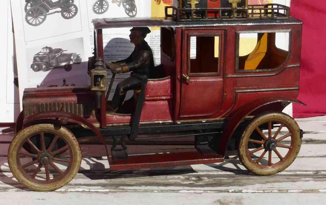 carette 3358/39 tin toy car travel limousine clockwork red