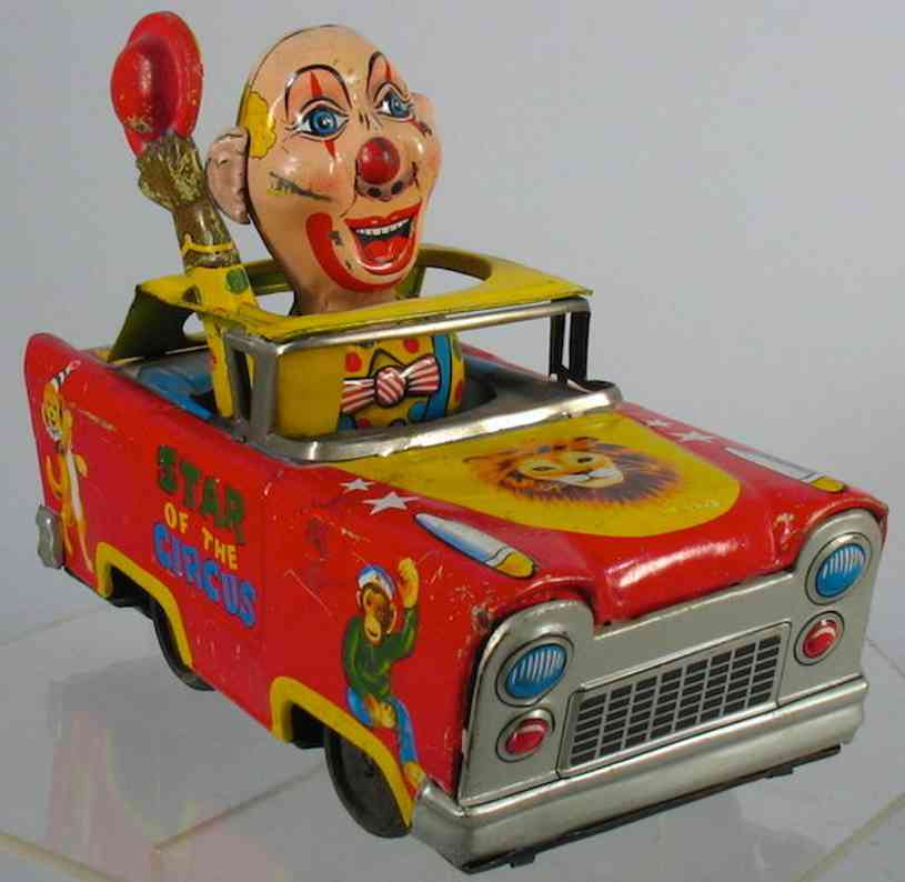 cragstan tin toy car star of the circus freakish clown