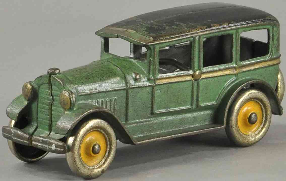dent hardware co cast iron toy car four door sedan green black gold