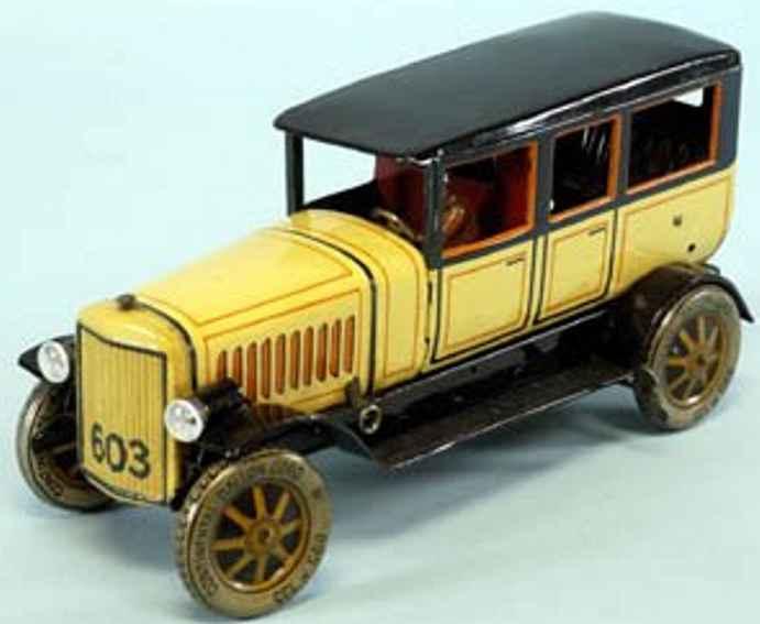 distler 603 tin toy car limousine luxury auto yellow