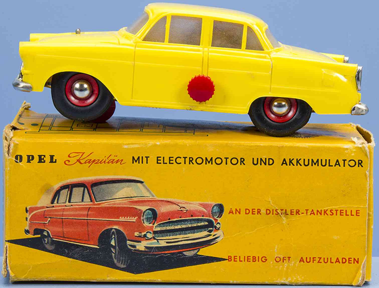 distler johann 7702 tin toy car opel kapitaen plastic in yellow