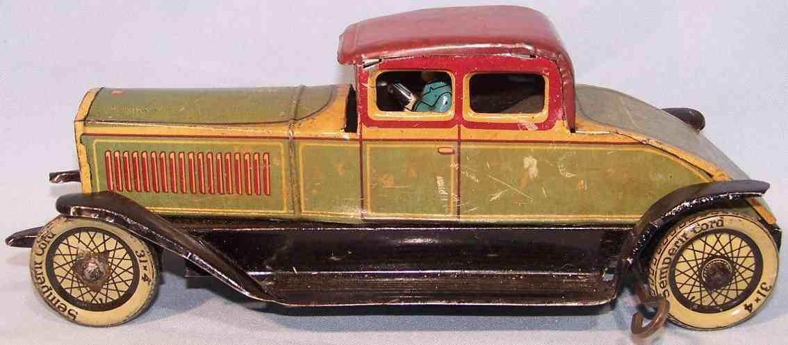 distler tin toy mother-in-law car green spring mechanism driver