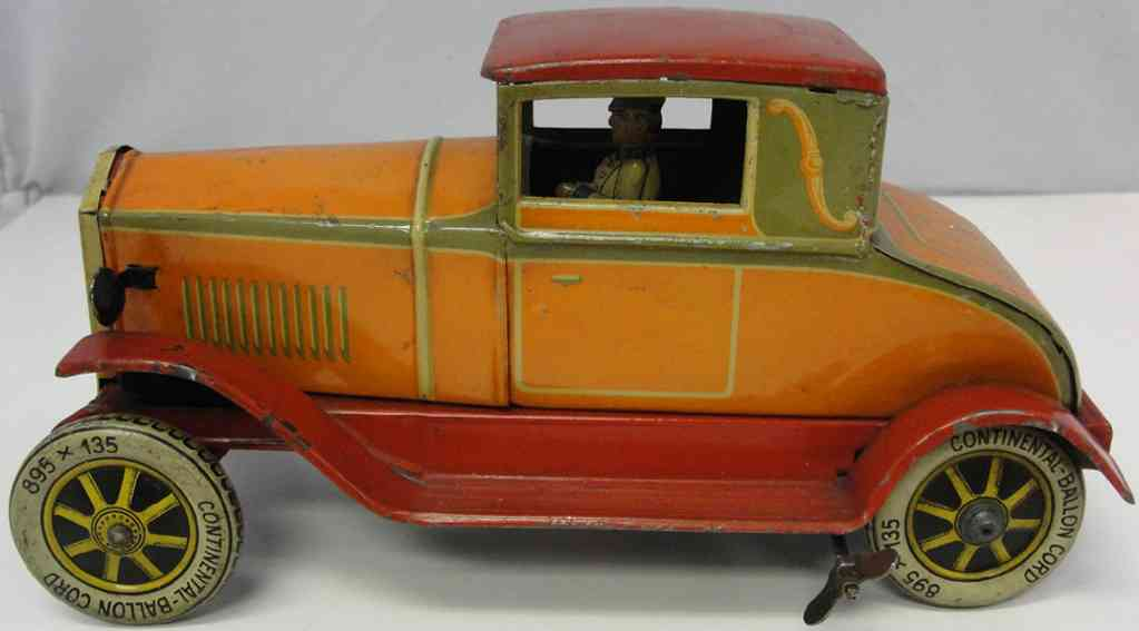 distler johann 718 tin toy car coupe in orange with wind-up