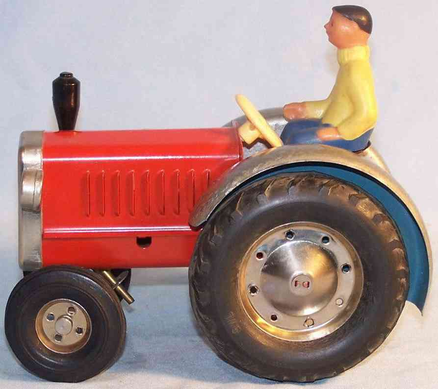 emka tin toy tractor with driver