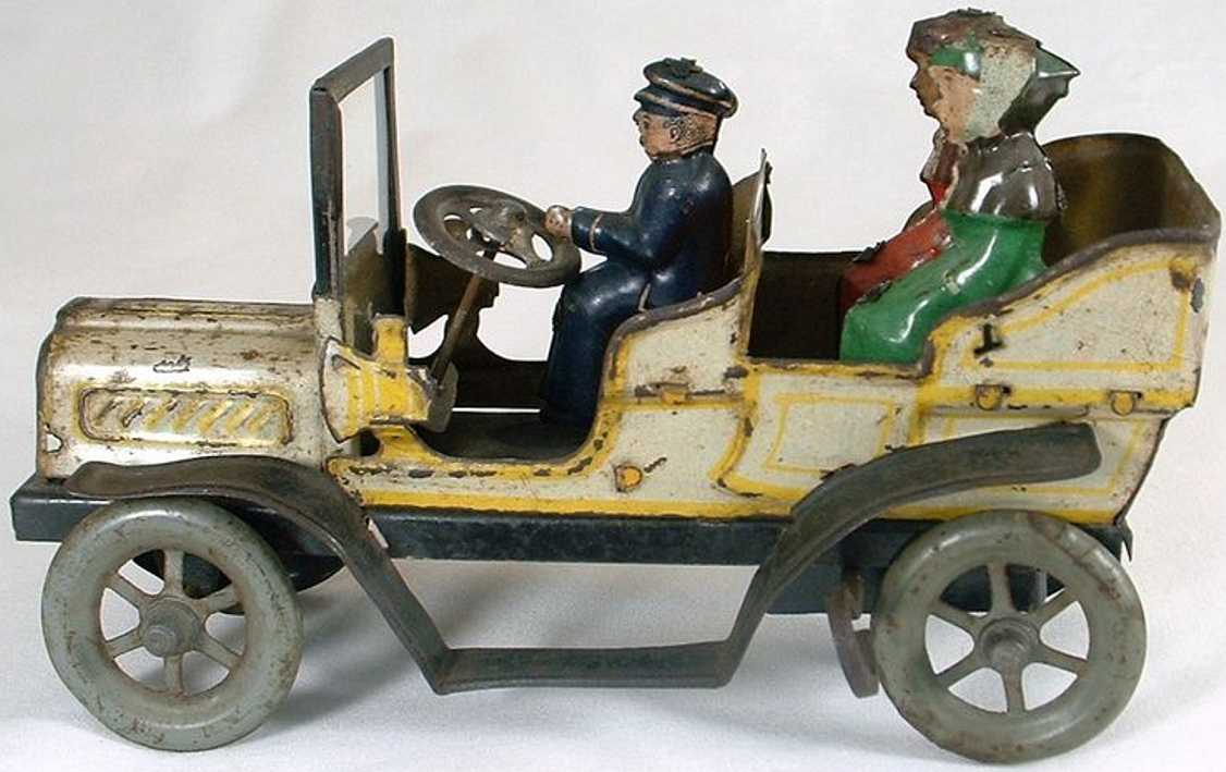 fischer georg tin wind-up toy car open touring car driver two passengers