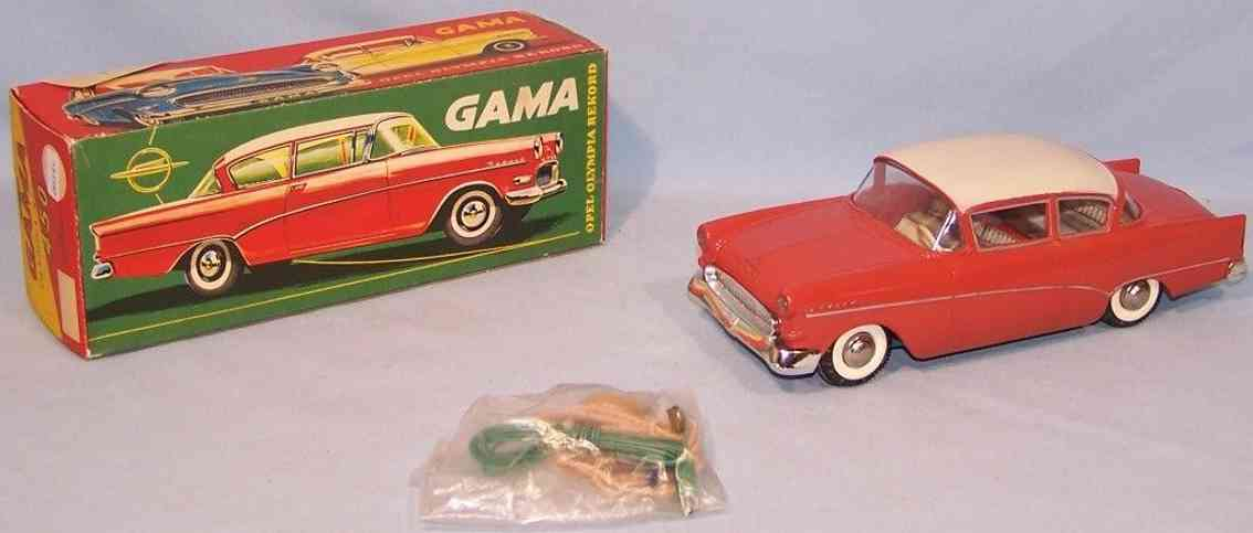 gama 452 celluloid toy opel olympia rekord plastic car tin coral red radio