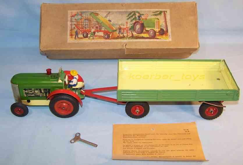 gescha 222/33 blech spielzeug traktor mit kippanhänger, fahrer und uhrwerk, grün, gelb und