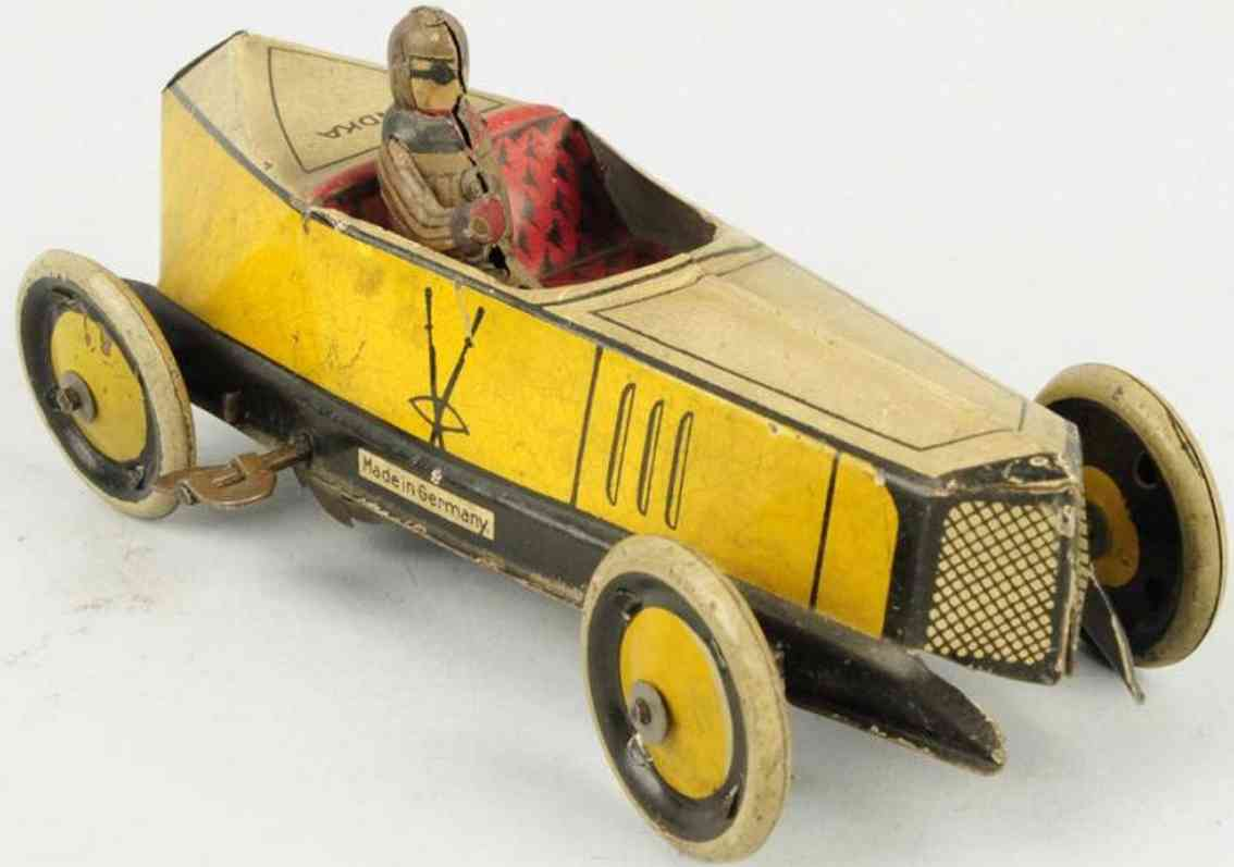 greppert & kelch 543 tin toy wind-up race car yellow driver